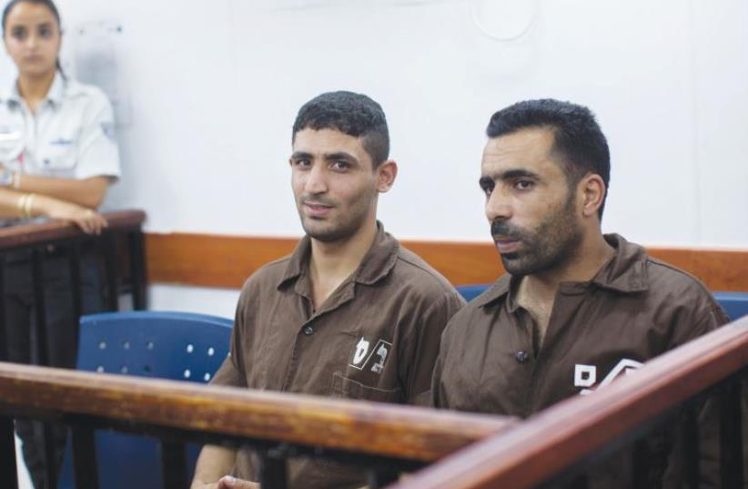 Two of the three terrorists indicted at Ofer military court yesterday for their alleged  involvement in the murder of Danny Gonen this June. (photo credit: YONATAN SINDEL/FLASH 90)