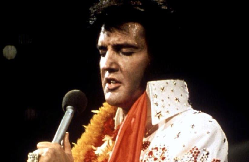 """Elvis Presley performs in concert during his """"Aloha From Hawaii"""" 1972 television special. (photo credit: REUTERS)"""
