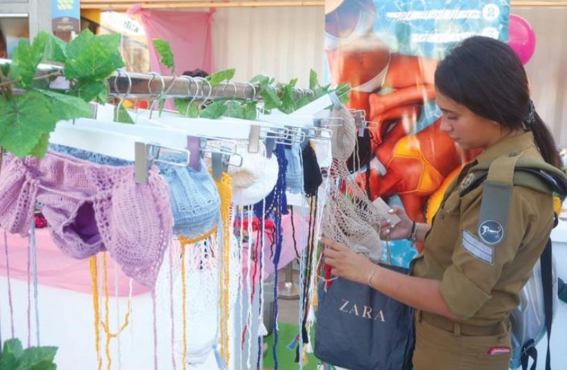Browsing for a bathing suit (photo credit: MARC ISRAEL SELLEM/THE JERUSALEM POST)