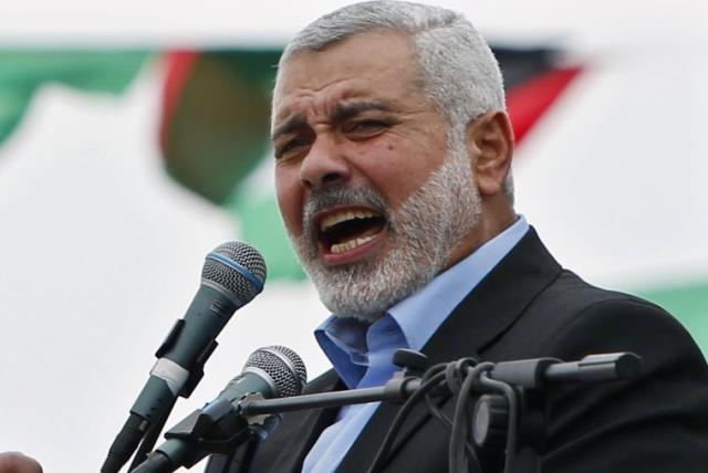 Ismail Haniyeh talks to his supporters during a Hamas rally in Gaza City (photo credit: REUTERS)