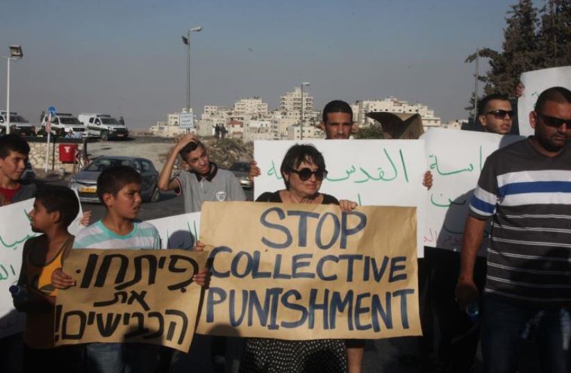 Protesters in Isawiya, east Jerusalem (photo credit: MARC ISRAEL SELLEM)