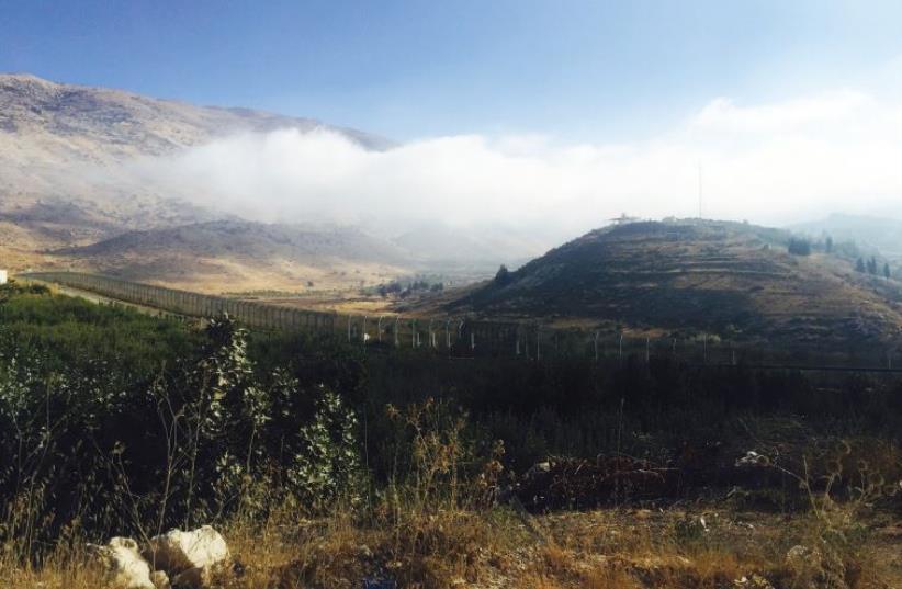 A VIEW ACROSS near Majdal Shams across the Golan border fence into Syria (photo credit: SETH J. FRANTZMAN)