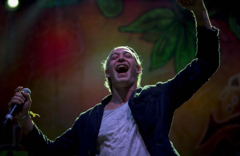 Jewish American singer Matisyahu performs during a concert at the Rototom Sunsplash Reggae festival (photo credit: BIEL ALINO / AFP)