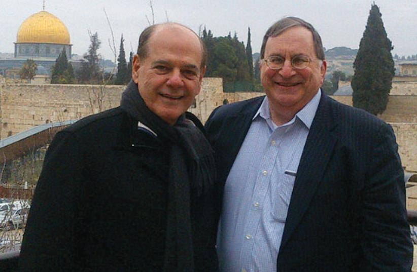 CESAR ALVAREZ (left) poses with Gary Epstein, head of the Israeli office of Greenberg Traurig, in Jerusalem's Old City. (photo credit: Courtesy)