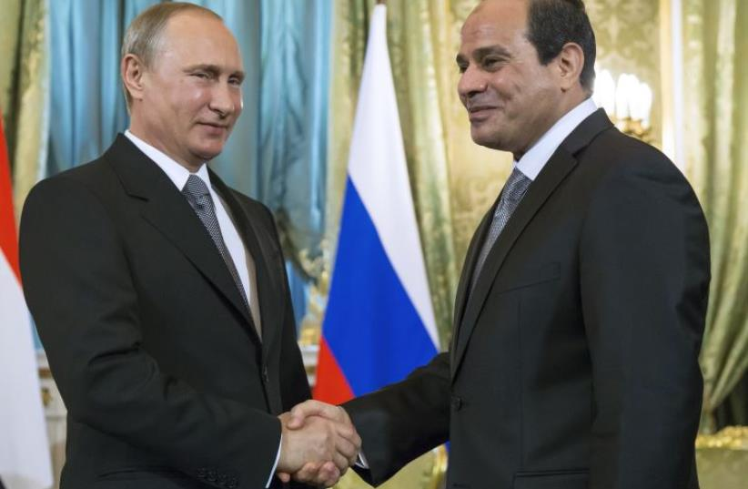 Russian President Vladimir Putin (L) shakes hands with his Egyptian counterpart Abdel Fattah al-Sisi during a meeting at the Kremlin in Moscow on August 26, 2015. (photo credit: AFP PHOTO / POOL / ALEXANDER ZEMLIANICHENKO)