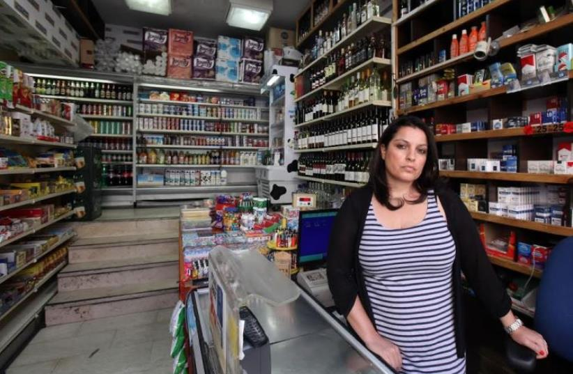 AN EMPLOYEE of the Makolet 24-hour market on Hillel Street, one of the eight markets being forced by the Jerusalem Municipality to close during Shabbat next month (photo credit: MARC ISRAEL SELLEM)