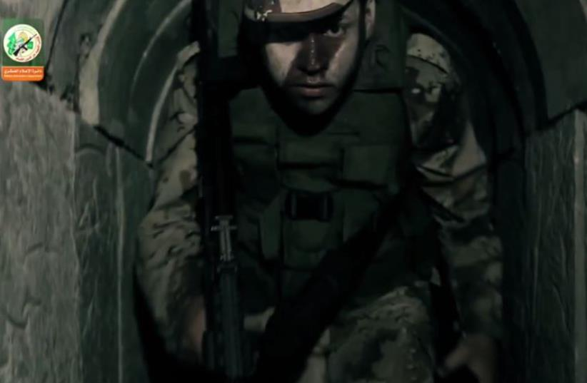 A Hamas operative in an underground tunnel in Gaza‏ (photo credit: screenshot)