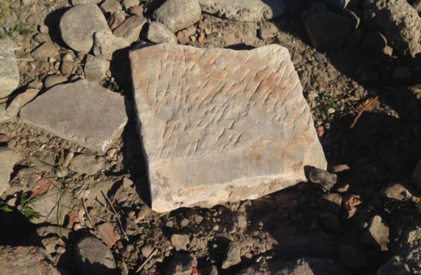Fragment of Jewish tombstone found in Vistula River (photo credit: COURTESY OF FROM THE DEPTHS)
