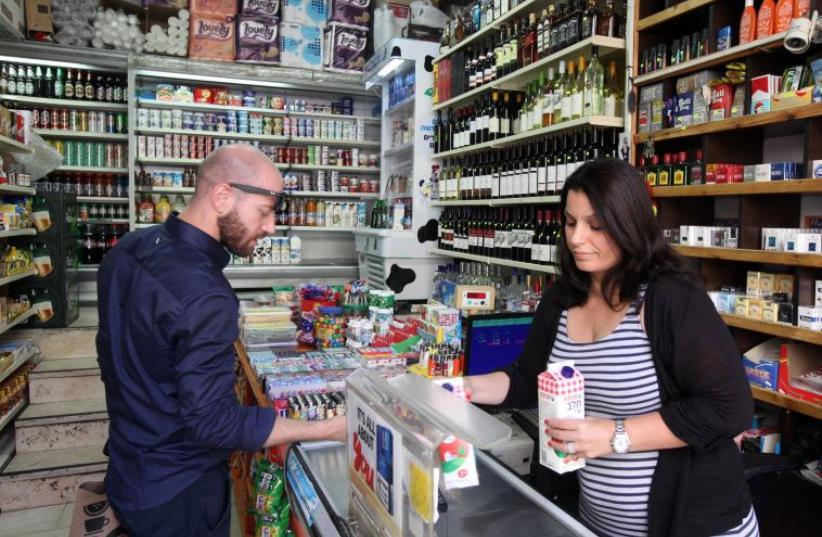 A convenience store in Jerusalem that is open on Shabbat (photo credit: MARC ISRAEL SELLEM/THE JERUSALEM POST)