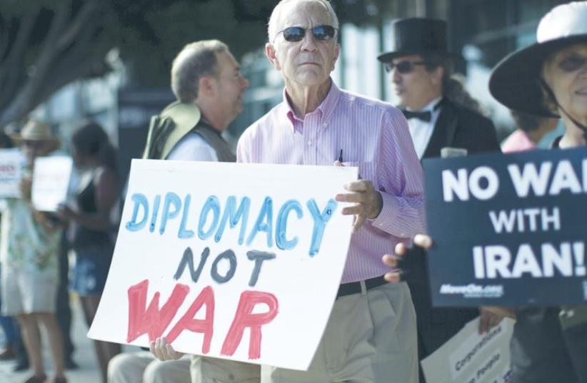 PEOPLE DEMONSTRATE in favor of the Iran nuclear deal in Los Angeles on Wednesday (photo credit: REUTERS)