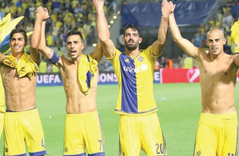 Maccabi Tel Aviv teammates celebrating their club's progress to the Champions League group stage, August 25, 2015 (photo credit: ADI AVISHAI)