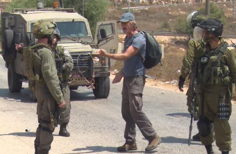 Israeli teacher confronts soldiers at Nabi Saleh (photo credit: screenshot)