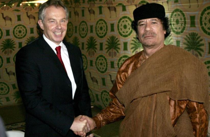 Britain's Prime Minister Tony Blair shakes hands with Libyan leader Muammar Gaddafi near Gaddafi's home town of Sirte May 29, 2007. (photo credit: REUTERS)