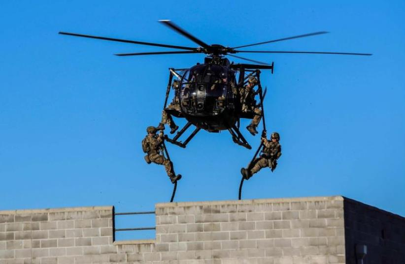 US special forces in action (photo credit: COURTESY USASOC)