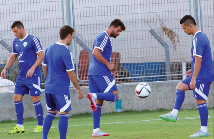 The Israel squad made its final preparations for tonight's Euro 2016 qualifier against Andorra yesterday, with (from left) Tomer Hemed, Bibras Natcho, Omri Ben-Harush, and Beram Kayal all vying for a starting role at Sammy Ofer Stadium in Haifa. (photo credit: ADI AVISHAI)