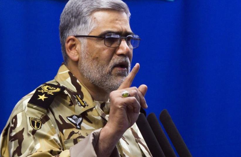 Commander of Iran's land force Ahmadreza Pourdastan speaks during Friday prayers in Tehran (photo credit: RAHEB HOMAVANDI/REUTERS)