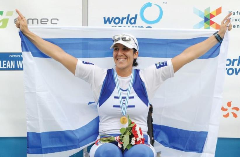 Israeli rower Moran Samuel claimed the gold medal in the arms-shoulders single scull 1,000-meter final at the World Rowing Championships in Aiguebelette, France (photo credit: DETLEV SEYB)
