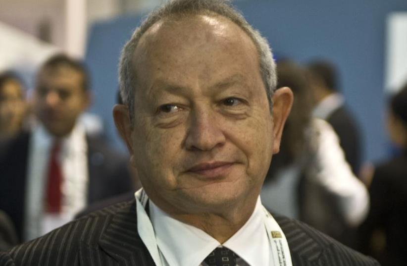 Egyptian billionaire Naguib Sawiris arrives for the Egypt Economic Development conference on March 13, 2015 (photo credit: AFP PHOTO / KHALED DESOUKI)