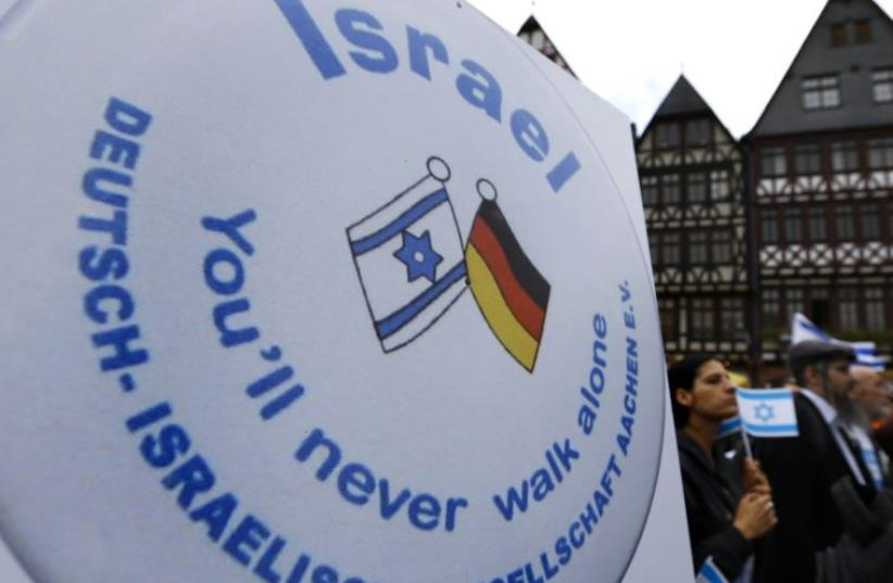 Protesters attend a rally against anti-Semitism in Frankfurt (photo credit: REUTERS)