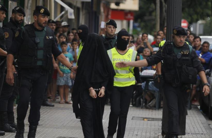 An 18-year-old Moroccan woman in Spain arrested under suspicions of being part of Islamic State.  (photo credit: JOSE JORDAN / AFP)
