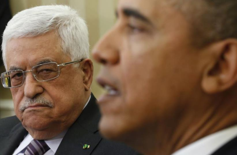 US President Barack Obama meets with Palestinian Authority President Mahmoud Abbas (L) at the White House (photo credit: REUTERS)