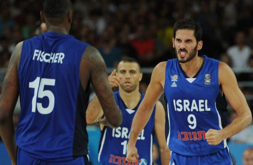 Israel's Omri Casspi (R) reacts during the group A qualification basketball match between Finland and Israel at the Euro Basket 2015 in Montpellier on September 6 2015.  (photo credit: AFP PHOTO / SYLVAIN THOMAS)