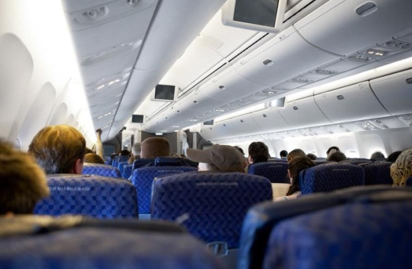 Interior of a passenger airplane (photo credit: INGIMAGE)