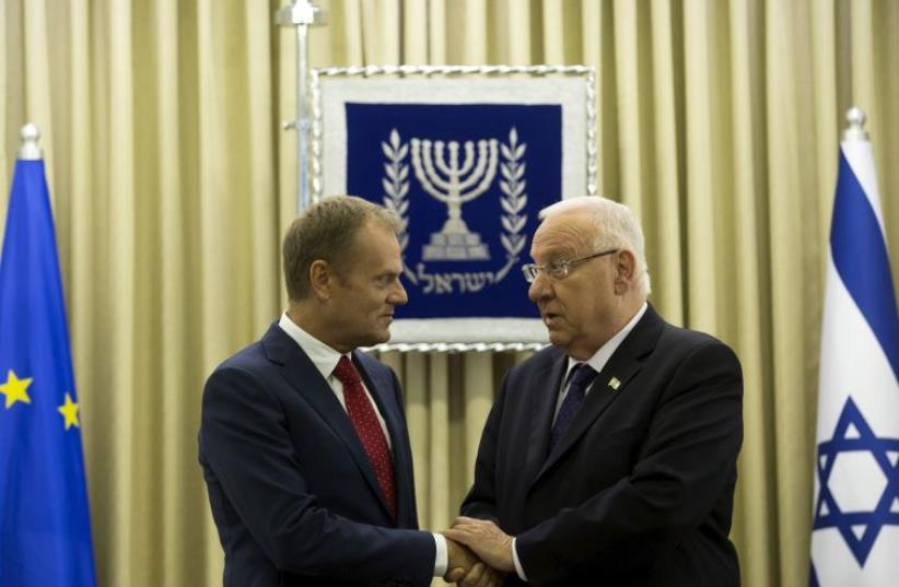 Israel's President Reuven Rivlin shakes hands with European Council President Donald Tusk during their meeting in Jerusalem September 8, 2015 (photo credit: REUTERS)