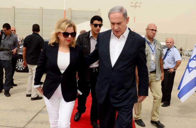 Benjamin and Sara Netanyahu at Ben Gurion Airport (photo credit: PRIME MINISTER'S OFFICE)