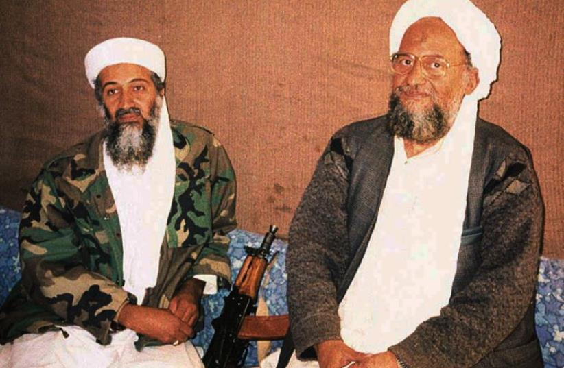 al-Qaida cheif Ayman al-Zawahiri sits with predecessor Osama Bin Laden during an interview in 2001  (photo credit: REUTERS)