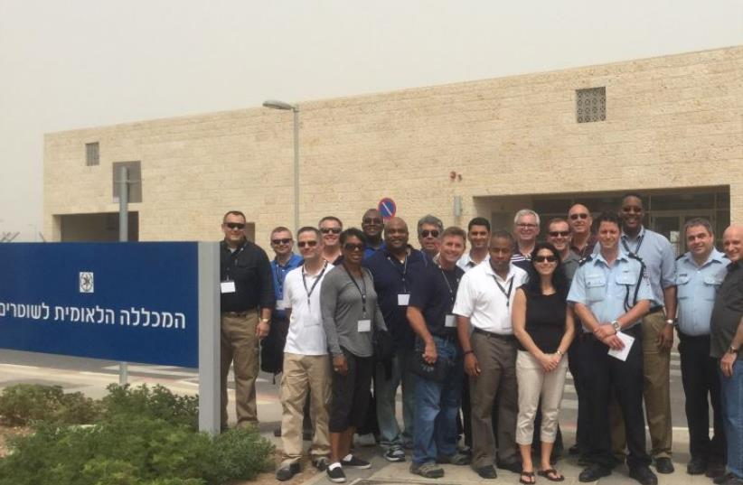 American law-enforcment delegates stand next to their Israeli counterparts at Israel's National Police Academy (photo credit: BEN HARTMAN)
