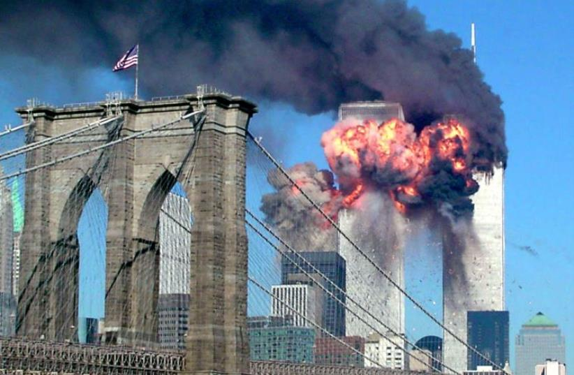 The second tower of the World Trade Center bursts into flames after being hit by a hijacked airplane in New York on September 11, 2001. (photo credit: REUTERS)