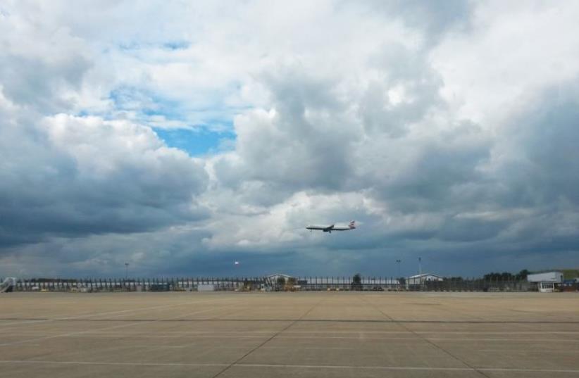 A BRITISH AIRWAYS flight lands at Heathrow Airport (photo credit: AMY SPIRO)