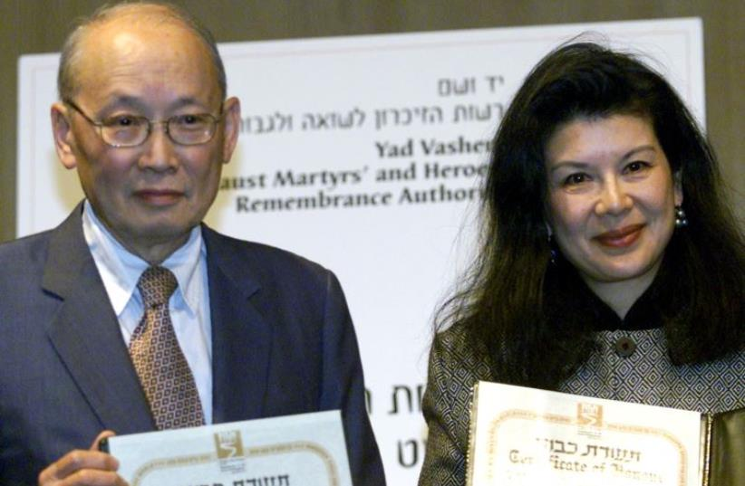 """Monto and Manli, the son and daughter of the late Chinese Consul-General in Vienna during 1938-40, Ho Feng Shan, display their """"Righteous Among The Nations"""" awards in the Yad Vashem Holocaust Memorial auditorium in Jerusalem (photo credit: REUTERS)"""