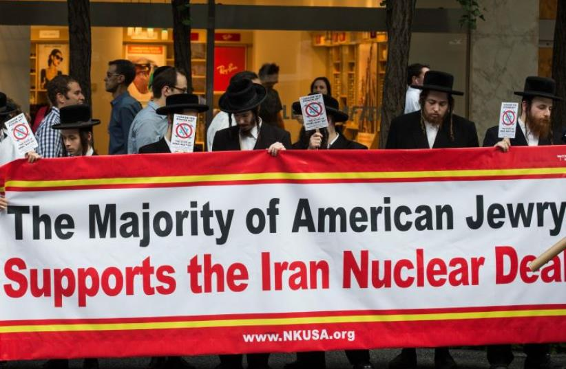 """Anti-Zionist Orthodox Jews throw a counter-protest across the street from a """"Stop Iran Rally,"""" where numerous US senators spoke, in the hopes of convincing other senators to denounce the Iran nuclear deal on September 1 (photo credit: AFP PHOTO)"""