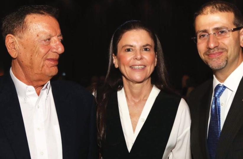 Ofra Strauss poses with her father and US Ambassador Daniel Shapiro at the anniversary gala (photo credit: ISRAEL-AMERICA CHAMBER OF COMMERCE)