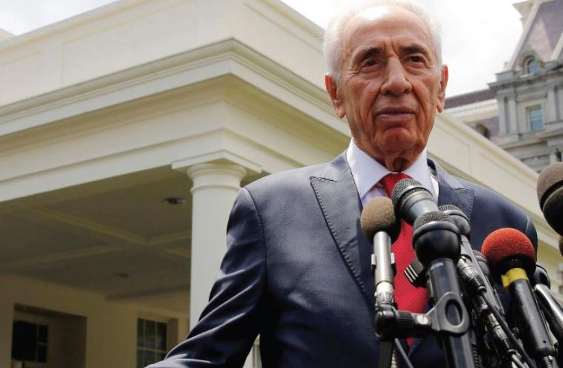 Former President Shimon Peres talks to the press after meeting with US President Barack Obama in the Oval Office of the White House during his presidency last June (photo credit: REUTERS)