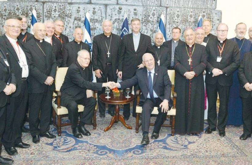 PRESIDENT REUVEN RIVLIN hosts the Council of the Bishops' Conferences of Europe at his residence in Jerusalem (photo credit: MARK NEYMAN / GPO)