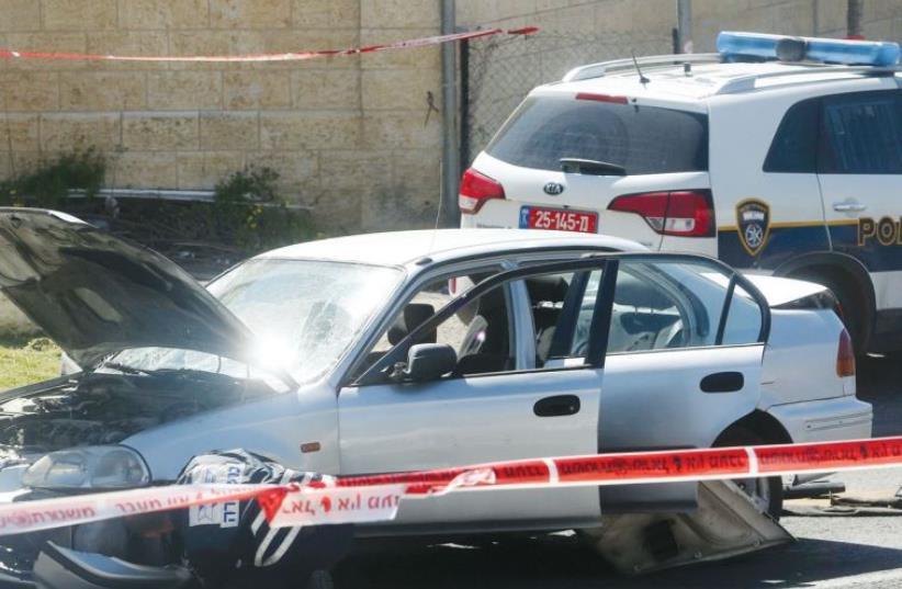 Illustrative photo of police at a crime scene (photo credit: MARC ISRAEL SELLEM/THE JERUSALEM POST)