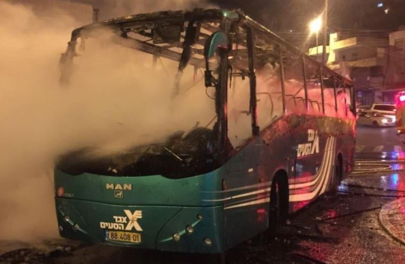 Israeli bus that went up in flames after being struck by a Molotov cocktail in Ras el-Amoud (photo credit: JERUSALEM FIRE AND RESCUE SERVICES)