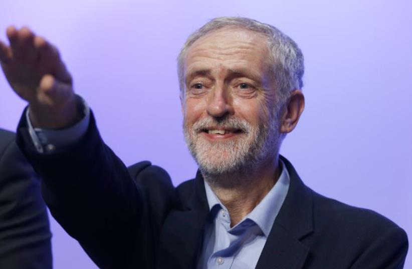 DATE IMPORTED: September 15, 2015 The new leader of Britain's opposition Labour Party Jeremy Corbyn gestures as he aknowledges applause after addressing the Trade Union Congress (TUC) in Brighton in southern England, September 15, 2015. (photo credit: PETER NICHOLLS/REUTERS)
