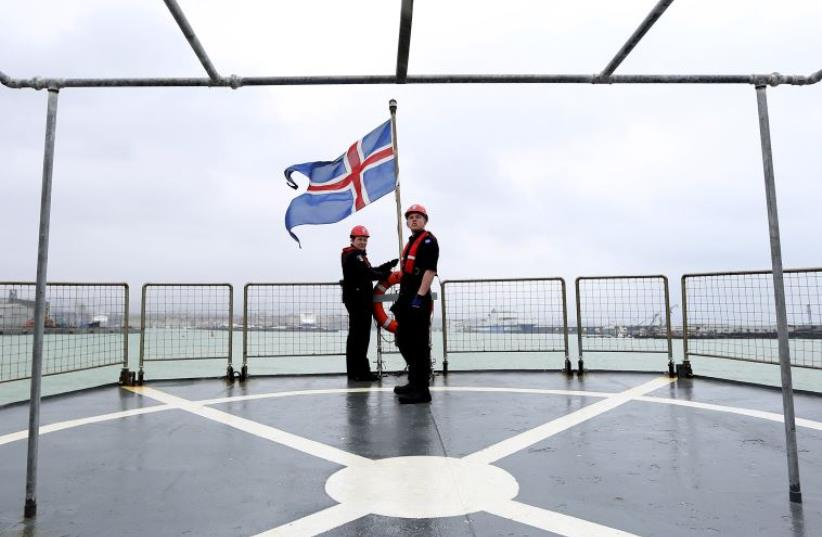 Icelandic coast guards hoist their national flag on the vessel Tyr as they sail from Catania harbour to off the eastern coast of Sicily March 17, 2015 (photo credit: REUTERS/ALESSANDRO BIANCHI)