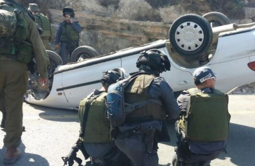 THE TERRORIST driver of this car ran down and wounded two soldiers on Route 60 in August, before he was shot and lost control of the car, which overturned (photo credit: TAZPIT)