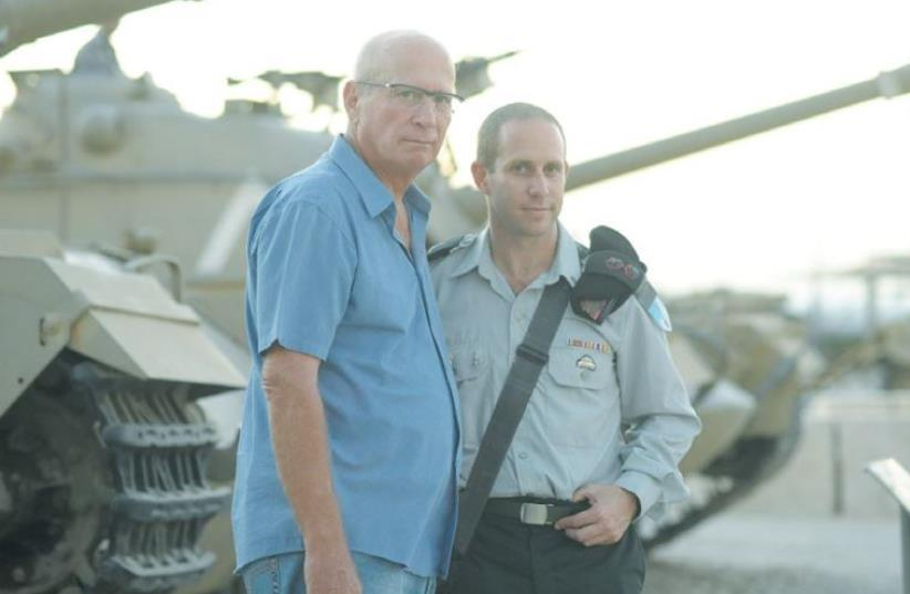 ZVIKA GREENGOLD (left) and Lt.-Col. Aryeh Berger, commander of the 74th Armored Battalion, pose at the Armored Corps Memorial at Latrun (photo credit: IDF SPOKESPERSON'S UNIT)