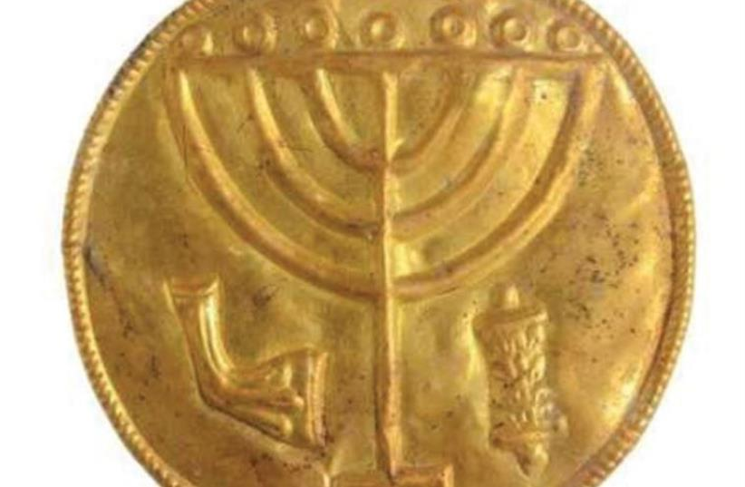 A 10 CM. medallion recently discovered at the foot of the Temple Mount with a menorah etched inside (photo credit: HEBREW UNIVERSITY)