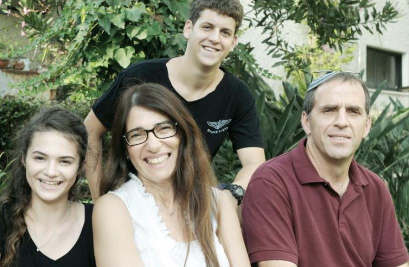 From right: Ehud Lipshitz, 50; Orly Nativ, 47; Assaf Amitai, 16; and Emily Nesterenko, 15 (photo credit: AVSHALOM SHOSHANI)