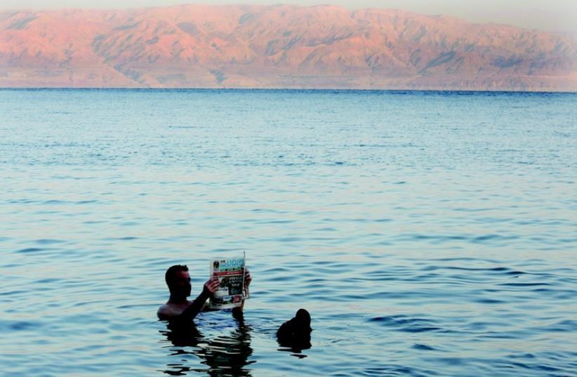 Détente à  la mer Morte (photo credit: MARC ISRAEL SELLEM/THE JERUSALEM POST)