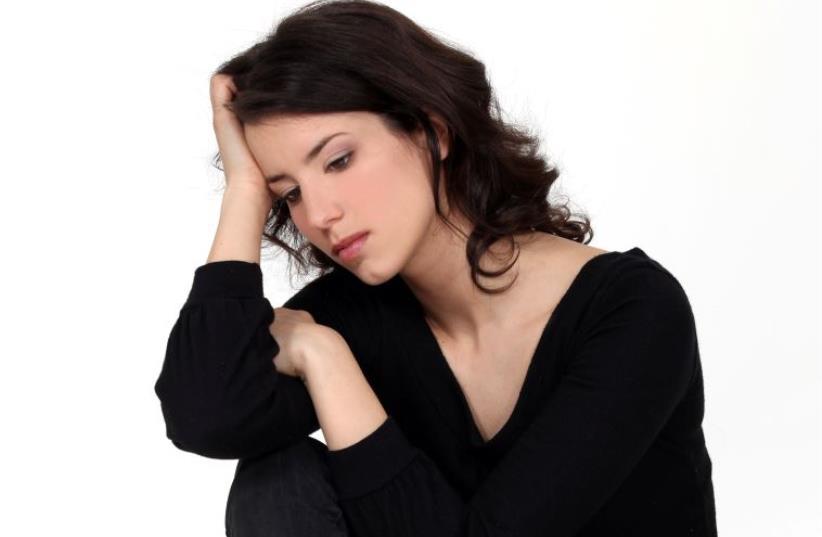A depressed woman (illustrative) (photo credit: INGIMAGE)