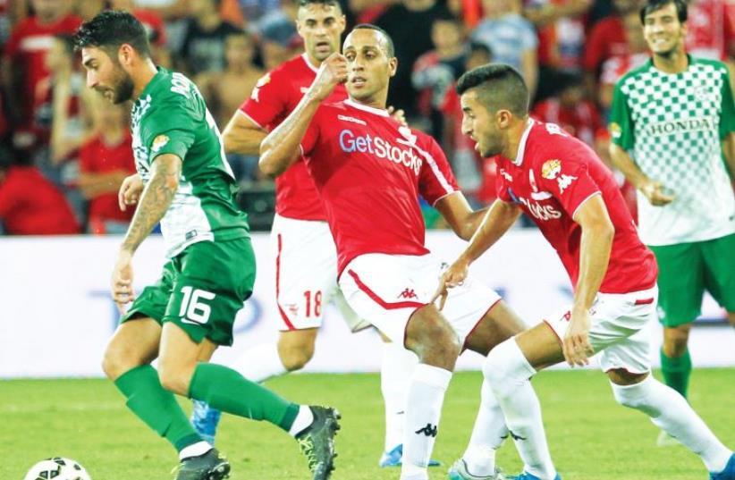 Maccabi Haifa striker Eliran Atar frustrated Hapoel Beersheba's Maharan Radi and Ben Biton  (photo credit: DANNY MARON)