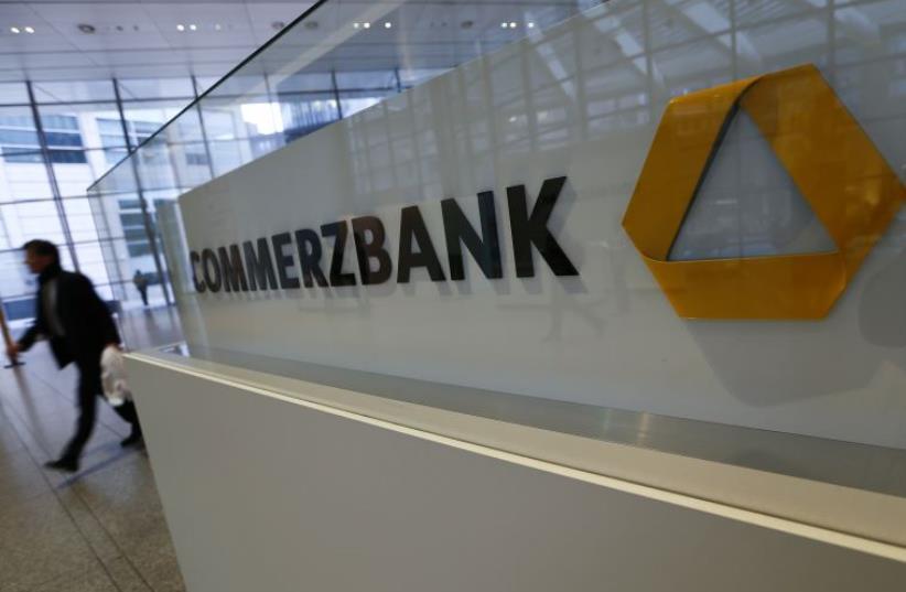 A man walks past a logo of Commerzbank (photo credit: REUTERS)